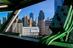 View of NYC from Captains deck of carrier Intrepid. The view of the New York City skyline including the Empire State Building from inside the captain's deck of Royalty Free Stock Image