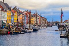 View of Nyhavn pier with color buildings and ships in Copenhagen, Denmark royalty free stock photography