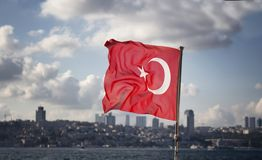 View o Turkish flag waving on a ferry boat royalty free stock photos