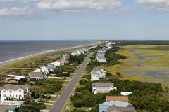 View of Oak Island, NC from a Lighthouse. Distant aerial view of Oak Island, NC coastal living homes road, marsh and more in the summer. Day high view of homes Royalty Free Stock Photography