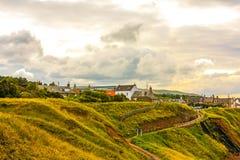 Scottish coastline with hills and houses, Scotland, UK  Stock Images