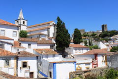 View of Obidos. Traditional white houses and a medieval cstle in Obidos, Portugal royalty free stock images