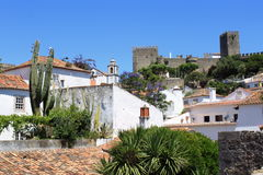 View of Obidos. Traditional white houses and a medieval castle in Obidos, Portugal royalty free stock images