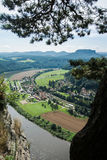 A view from observation desk of Bastei in Saxon Switzerland, Germany. A view from observation desk of Bastei in Saxon Switzerland, Germany to Kurort Rathen and Stock Photo