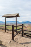 A view from observation desk with fence to fields, farms and mountains. Near Consuegra town at spring cloudy day Stock Photos