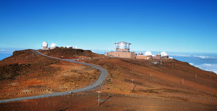 View of observatories from summit of Haleakala volcano Stock Images