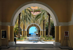 View of the ocean through the arches in Cabo San Lucas, Mexico. View of the beach and ocean through the arches at a resort in Cabo San Lucas, Mexico Stock Photo