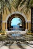 View of ocean through archway in Cabo San Lucas, Mexico. View of ocean therough archway, courtyard and fountain in Cabo San Lucas, Mexico stock photo