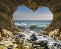 View of the ocean from a heart-shaped cave. Canary islands Stock Photos