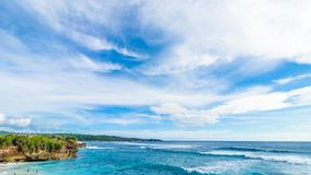 A view of the ocean and the horizon. Panorama Timelapse of tropical beach. Amazing clouds and waves crushing on the. Mountain. 4K time lapse. Bali island stock video footage