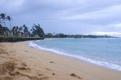 View of the ocean at Pono Kai Beach on a cloudy day. stock photos