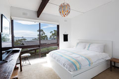 View of the ocean from a retro beach house bedroom Stock Image