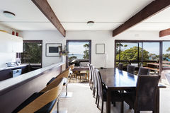 View of the ocean from retro beach house dining room Stock Photo