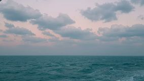 View of the ocean from a ship. Ocean at sunset.Waves behind the stern of the ship.