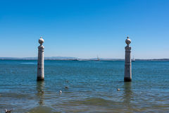 View of Ocean from Shore of Comercio Square in Lisbon Portugal L Royalty Free Stock Photo