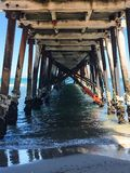 Underneath an ocean Jetty. View of ocean from royalty free stock photos
