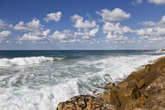 View of the ocean waves lapping on the shore. Lovely view of the ocean waves lapping on the shore Royalty Free Stock Photo