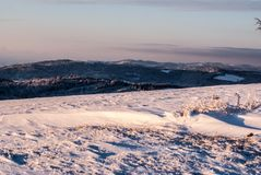 View from Ochodzita hill above Koniakow village in Beskid Slaski mountains during winter. Morning with snow and blue sky Royalty Free Stock Photos