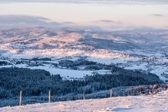 View from Ochodzita hill above Koniakow village in Silesian Beskids mountains in Poland during freezing winter morning. View from Ochodzita hill above Koniakow royalty free stock photos