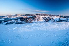 View from Ochodzita hill above Koniakow village in Silesian Beskids mountains in Poland during winter. Morning with snow and blue sky royalty free stock image