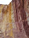 View of the Ochre pits. White yellow and red layers in the walls of Ochre pits in the West MacDonnell Ranges in the northern Territories in Australia Royalty Free Stock Image