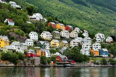 View of the Odda town in Hordaland county, Norway. A popular tourist destination located at the end of the Sorfjorden is the base village for hikes to stock photo