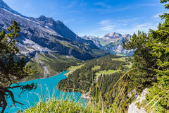 View of Oeschinensee (Oeschinen lake) and the valley on bernese Stock Images