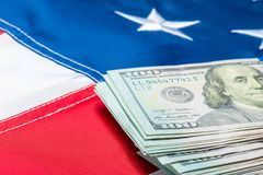 View Of A Stack Of Money Lying On The Flag Of The United States Of America Stock Photos