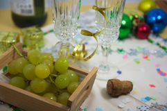 Free View Of A Table Ready To Celebrate Christmas Where You Can See Tall Glasses Of Champagne Or Cava, Lucky Grapes To Celebrate The En Stock Photography - 129455252