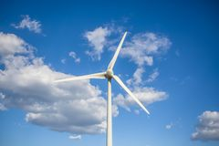 Free View Of A Wind Turbine On Top Of Mountains, Blue Sky As Background Royalty Free Stock Photos - 160206358