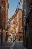 View Of Alley With Townhouses And Pedestrians In Draguignan. Stock Images