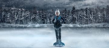 Free View Of Child  Figure Skater On Winter Lake Stock Photo - 159435110