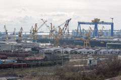 View Of Industrial Port With Cranes