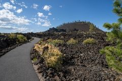 Free View Of Lava Butte In Lava Lands At Newberry National Volcanic Monument In Central Oregon, With Paved Hiking Trail Royalty Free Stock Image - 157207486