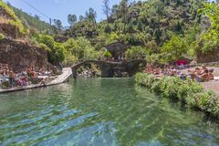Free View Of Natural Pools In The Village Of Piodao, With People Taking Sunbath And Schist Houses And Bridge Stock Photos - 212882233