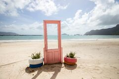 Free View Of Pink Door With Plants In Tires On Both Sides At The Seashore In Con Dao, Vietnam Royalty Free Stock Photography - 193882297