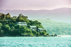 View Of Seychelles Coastline With Houses In The Forest Stock Image