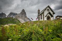 View Of Small Church In The Famous Passo Rolle With Pale Di San Martino In The Background, Italian Dolomites, Trentino Stock Photos