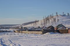 View Of Small Local Village And Forest Mountain In Winter At Khovsgol In Mongolia Stock Photo