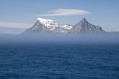 Free View Of South Georgia Island From The Sea With Mist Royalty Free Stock Photo - 142275195