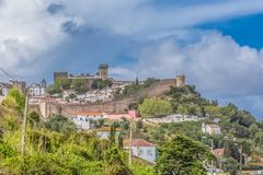 Free View Of The Fortress And Luso Roman Castle Of Óbidos, With Buildings Of Portuguese Vernacular Architecture And Sky With Clouds, Stock Images - 146505694