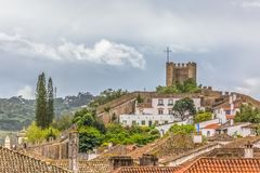 Free View Of The Fortress And Luso Roman Castle Of Óbidos, With Buildings Of Portuguese Vernacular Architecture And Sky With Clouds, Stock Image - 146755201