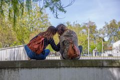 Free View Of Two Girlfriends Girls Sitting On A Wall And Looking At The Landscape Hand In Hand And Lovingly Stock Images - 162569054
