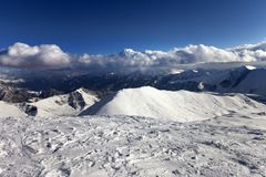 View on off-piste slope and snowy mountains Royalty Free Stock Images