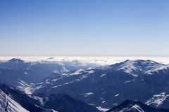 View from off-piste slope on snowy mountains in haze Stock Image