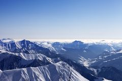 View from off-piste slope on snowy rocks in haze Stock Images