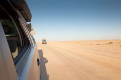 Off-road in Namibia. View from off-road vehicle on the desert road. Motion Royalty Free Stock Photography