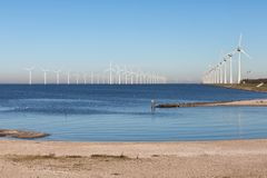 View at off shore wind turbine farm from beach Urk. View at off shore wind turbine farm from beach former island Urk, The Netherlands royalty free stock image