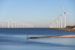 View at off shore wind turbine farm from beach Urk. View at off shore wind turbine farm from beach former island Urk, The Netherlands stock photo