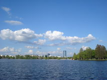 View of office buildings over Herastrau lake in Bucharest Royalty Free Stock Photography